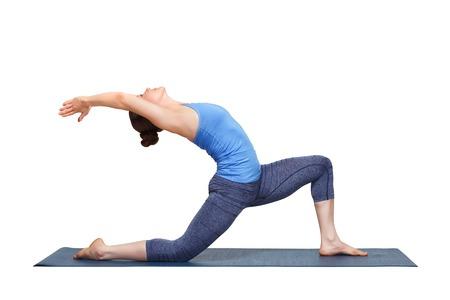 namaskar: Beautiful sporty fit yogini woman practices yoga asana  Anjaneyasana - low crescent lunge pose in surya namaskar in studio isolated on white