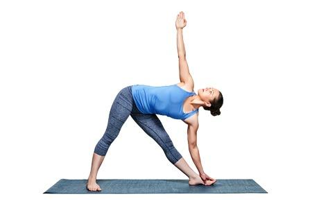 trikonasana: Beautiful sporty fit woman practices Ashtanga Vinyasa yoga asana utthita trikonasana - extended triangle pose isolated on white