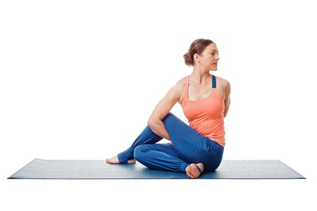 sitted: Woman doing Ashtanga Vinyasa Yoga asana  Marichyasana D - sitted spinal twist pose posture easy variation isolated on white background