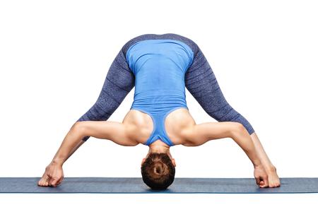 legged: Beautiful sporty fit woman practices Ashtanga Vinyasa yoga asana Prasarita padottanasana D - wide legged forward bend D isolated on white