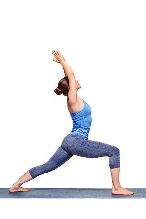 Beautiful sporty fit yogini woman practices yoga asana Virabhadrasana 1 - warrior pose 1 isolated on white Stock Photo