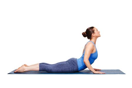 Beautiful sporty fit yogini woman practices yoga asana bhujangasana - cobra pose in studio isolated on white Archivio Fotografico