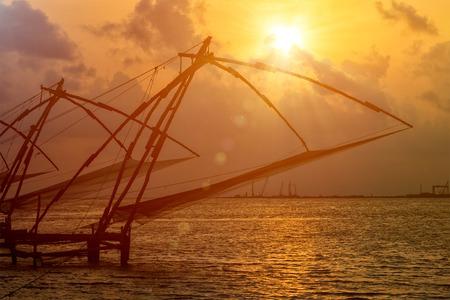 Kochi chinese fishnets on sunset in Fort Kochin, Kochi, Kerala, India Stock Photo