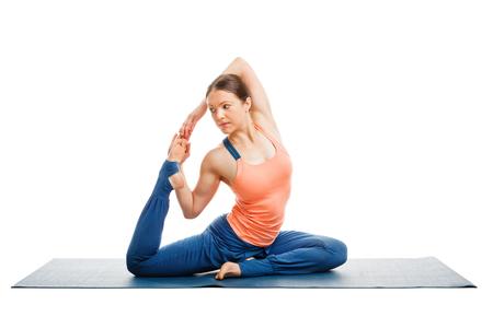 pada: Hatha yoga - sporty fit woman doing yoga asana Eka pada kapotasana - one-legged pigeon pose isolated on white