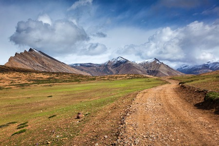 pradesh: Road in mountains (Himalayas). Spiti Valley,  Himachal Pradesh, India Stock Photo