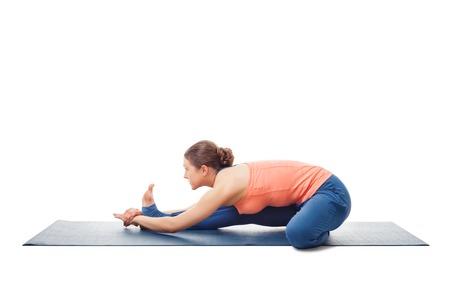 hatha: Woman doing Ashtanga Vinyasa Yoga asana Janu sirsasana B - head-to-knee pose B isolated on white background