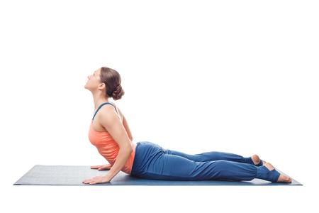 bhujangasana: Beautiful sporty fit yogini woman practices yoga asana bhujangasana - cobra pose in studio isolated on white Stock Photo