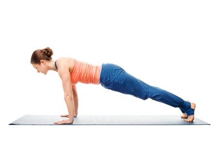 Woman doing yoga asana Utthita chaturanga dandasana (or phalakasana) - extended four-limbed posture plank pose isolated on white background