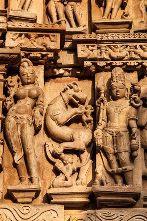Stone carving bas relief sculptures on Vaman Temple, Khajuraho, Madhya Pradesh, India Stock Photo