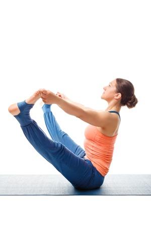 Beautiful sporty fit woman doing Ashtanga Vinyasa yoga asana Upavistha konasana B - wide sitted forward bend B isolated on white