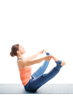 konasana: Beautiful sporty fit woman doing Ashtanga Vinyasa yoga asana Upavistha konasana B - wide sitted forward bend B isolated on white