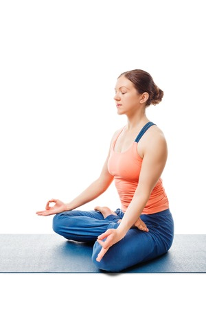 Woman doing Yoga meditation asana Padmasana - lotus pose posture with chin mudra isolated on white background