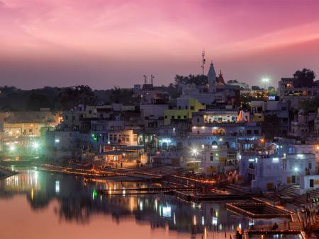 sagar: Sacred Puskhar lake (Sagar) and ghats of  town Pushkar in twilight in the evening, Rajasthan, India Stock Photo