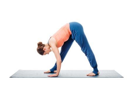 intense: Woman doing Ashtanga Vinyasa Yoga asana Parsvottanasana - intense side stretch pose isolated on white background Stock Photo