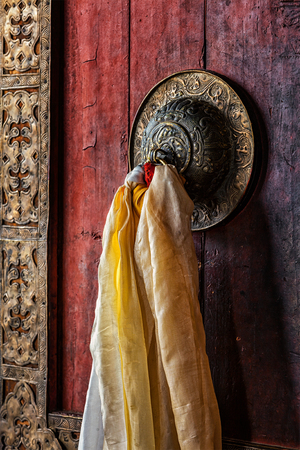 Decorated door handle of gates of Thiksey gompa (Tibetan Buddhist monastery). Ladakh, India Stock Photo