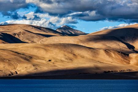 Himalayas and Himalayan mountain lake Tso Moriri on sunset. Korzok, Changthang area, Ladakh, Jammu and Kashmir, India