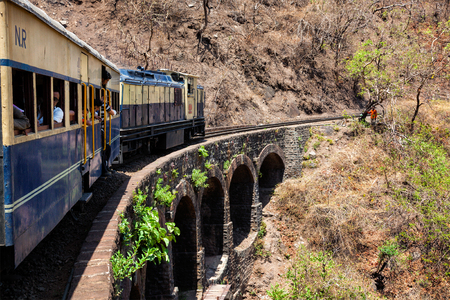 HIMACHAL PRADESH, INDIA - MAY 12, 2010: Toy train of Kalka Shimla Railway - narrow gauge railway built in 1898 and famous for its scenery and improbable construction.