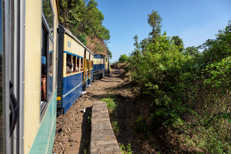 narrow gauge railroads: HIMACHAL PRADESH, INDIA - MAY 12, 2010: Toy train of Kalka Shimla Railway - narrow gauge railway built in 1898 and famous for its scenery and improbable construction.