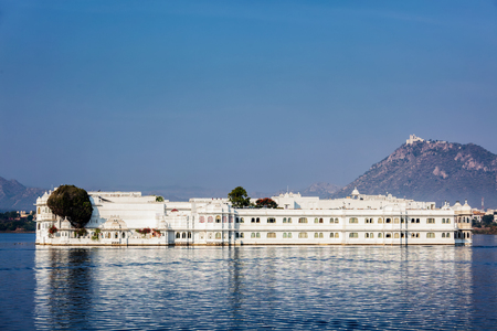 UDAIPUR, INDIA - NOVEMBER 23, 2012: Lake Palace (Jag Niwas) in Lake Pichola, Udaipur, Rajasthan. Lake Palace is a famous luxury hotel and has been voted as the most romantic hotel in India and in the world. Was featured in James Bond film Octopussy as the