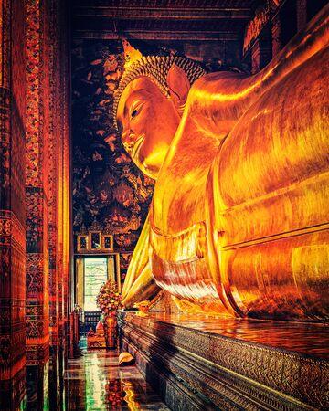 Vintage retro effect filtered hipster style image of reclining Buddha gold statue. Wat Pho, Bangkok, Thailand