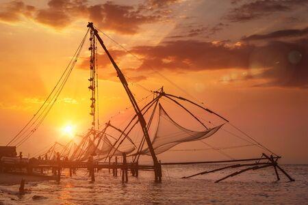 chinese fishing nets: Chinese fishnets on sunset. Kochi, Kerala, India Stock Photo