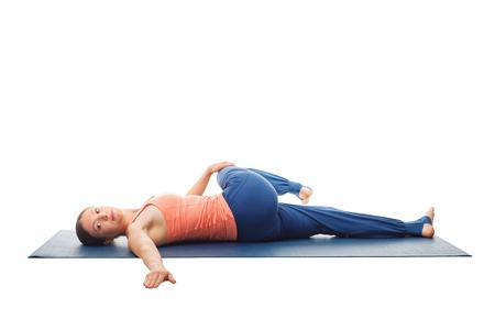 Woman doing Yoga asana Parivrtta ardha pawanmuktasana isolated