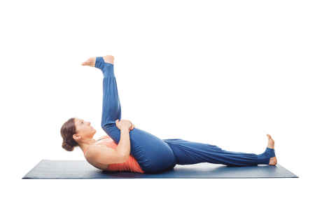 Woman doing Yoga asana Supta padangusthasana isolated Stock Photo
