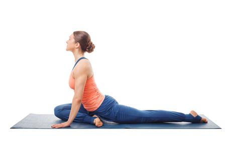 pada: Woman doing yoga asana Eka pada kapotasana Stock Photo