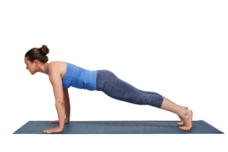 plank position: Woman doing yoga Surya Namaskar Sun Salutation asana Utthita cha Stock Photo