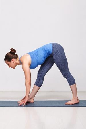 Woman doing Ashtanga Vinyasa yoga asana Parsvottanasana