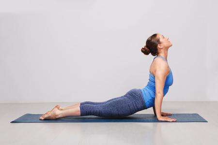 Woman doing Ashtanga Vinyasa yoga asana Urdhva mukha svanasana