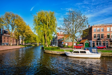 Boats, houses and canal. Harlem, Netherlands Stock Photo