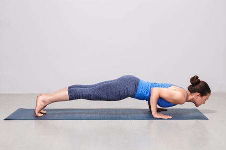 Woman doing Ashtanga Vinyasa yoga Surya Namaskar Sun Salutation