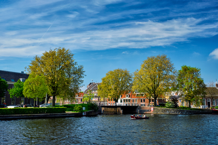 Boat in canal and Spaarne river in Haarlem, Netherlands