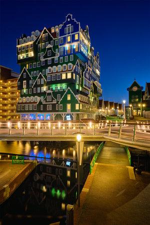 Inntel Hotel in Zaandam illuminated at night, Netherlands