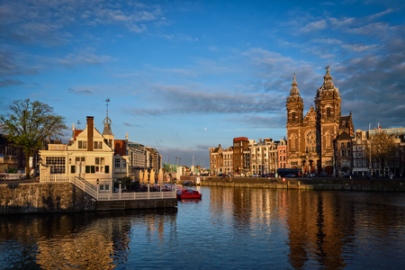 Amsterdam canal and Church of Saint Nicholas on sunset