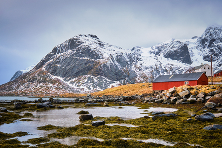 Red rorbu house and fjord in Norway Stock Photo