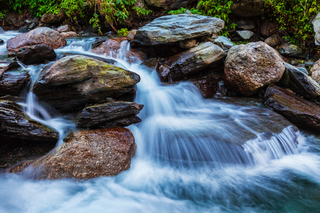 Cascade of Bhagsu waterfall. Bhagsu, Himachal Pradesh, India. Polarizer filter used