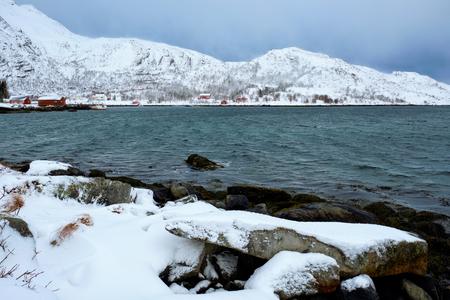 Norwegian fjord with red rorbu houses in Norway in winter