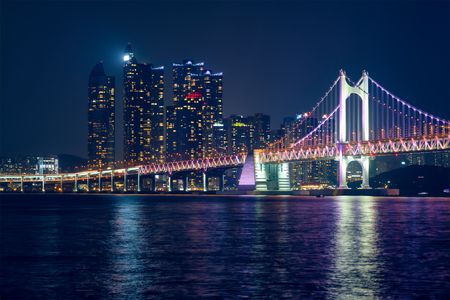 Gwangan Bridge and skyscrapers in the night. Busan, South Korea Stock Photo