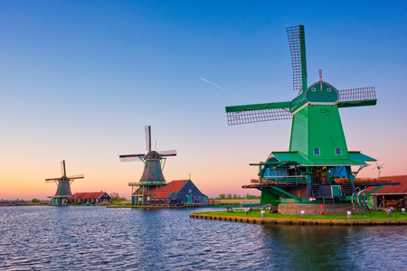 Windmills at Zaanse Schans in Holland on sunset. Zaandam, Netherlands Imagens