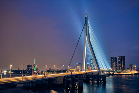 Erasmus Bridge (Erasmusbrug) and Rotterdam skyline illuminated at night. Rotterdam, Netherlands Reklamní fotografie