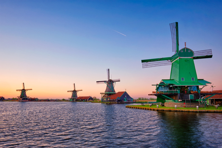 Windmills at Zaanse Schans in Holland on sunset. Zaandam, Netherlands Reklamní fotografie