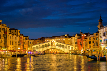 Rialto bridge Ponte di Rialto over Grand Canal at night in Venice, Italy