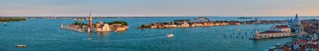 Aerial panorama of Venice lagoon with boats and San Giorgio di Maggiore church. Venice, Italy