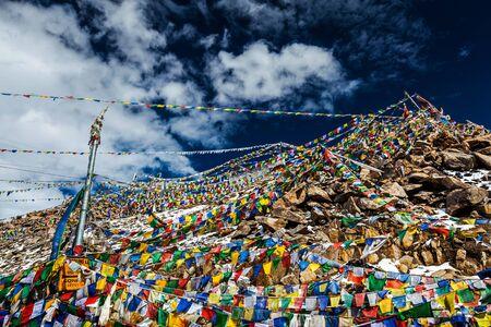 Tibetan Buddhist prayer flags on top of Khardung La pass. Highest motorable pass in the world 5602 m