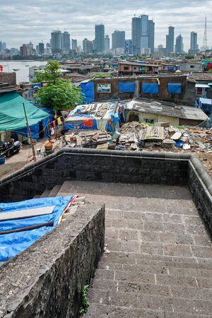 View of Mumbai skyline over slums in Bandra suburb Stock Photo