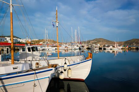 Fishing boats in port of Naousa on sunrise. Paros lsland, Greece