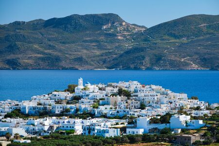 View of Plaka village with traditional Greek church. Milos island, Greece