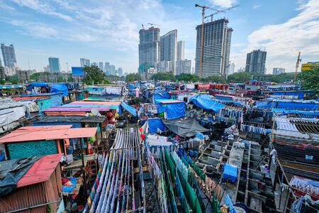 Dhobi Ghat is an open air laundromat lavoir in Mumbai, India with laundry drying on ropes Standard-Bild